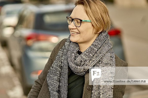 Smiling woman at street in city Munich  Germany