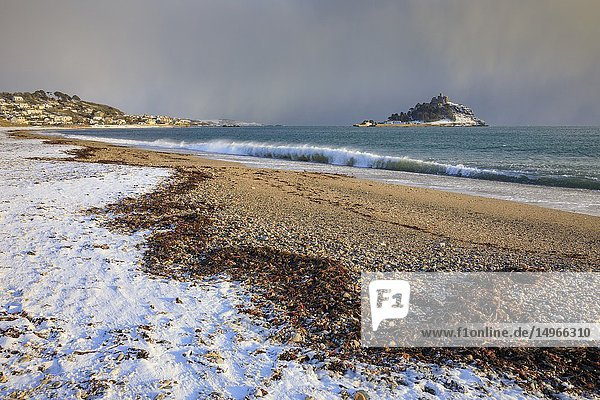 Snow on the beach at Long Rock in Cornwall  with St Michael's Mount in the distance. The image was captured on an atmospheric afternoon  following a snowfall in early February.