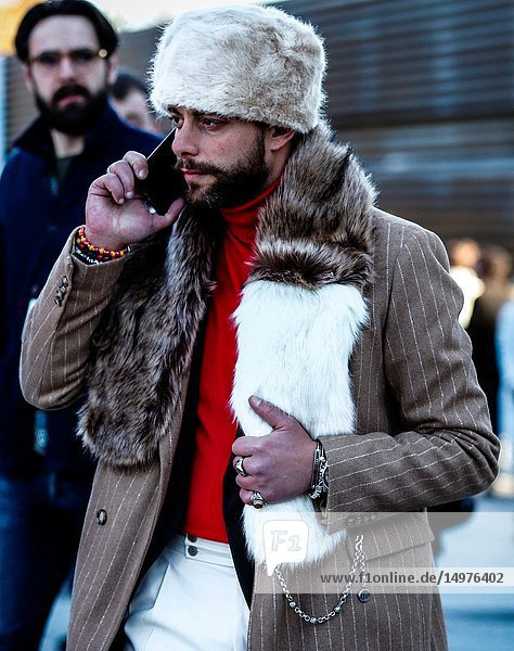 FLORENCE,  Italy- January 10 2019: Men on the street during the Pitti 95.