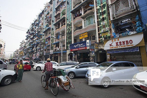 Daily life in Bo Soon Pat street  Sule Pagoda area  city center  Yangon  Myanmar  Asia.