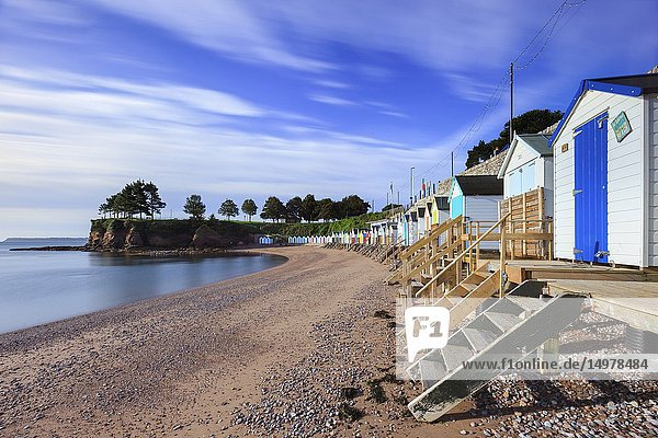 A row of beach huts on Corbyn Head Beach near Torquay on the south coast of Devon. A long shutter speed was utilised to blur the movement in the fast moving clouds.
