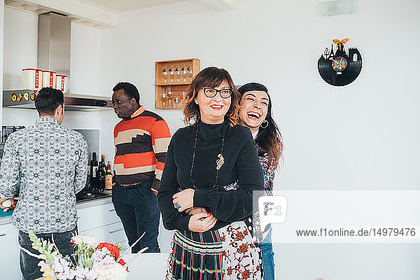 Friends talking and having fun at party in loft office