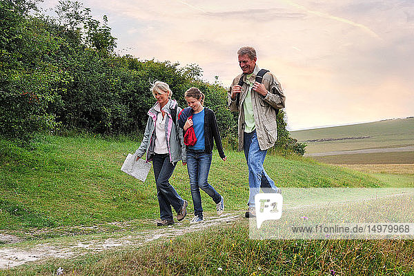 Family of three exploring countryside  Eastbourne  East Sussex  United Kingdom