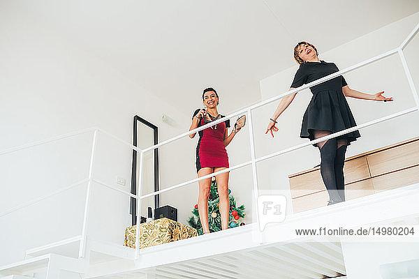 Girlfriends play acting on loft