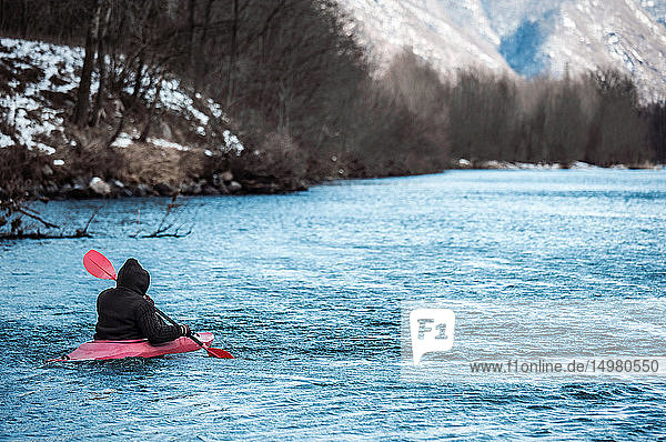 Male kayaker kayaking on river  rear view  Domodossola  Piemonte  Italy