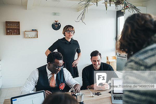 Businessmen and businesswomen working in loft office