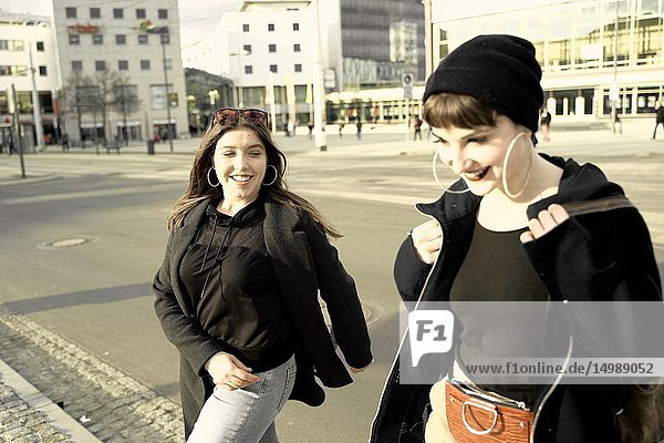 Two women walking in city Cottbus  Brandenburg  Germany