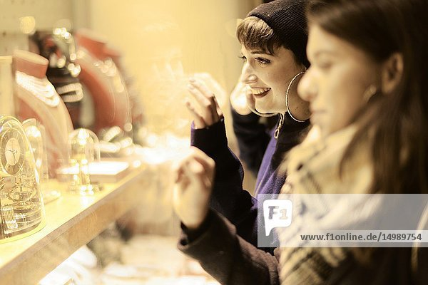 Two women looking at expensive luxury jewellery in store at shop window  unattainable desire to buy  in city Cottbus  Brandenburg  Germany.