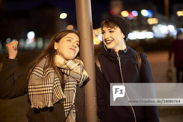 Two friends at night  in city Cottbus  Brandenburg  Germany.