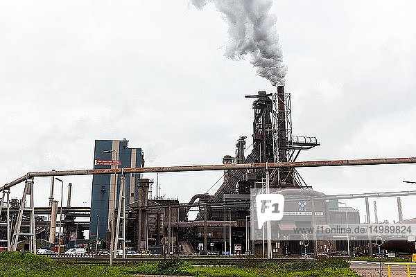 IJmuiden  Netherlands. Huge  heavy steel production plant and industry terrain  producing various kinds of steel inside an CO2 emitting factory. The steel plant is called Hoogovens and is owned by Tata Steel  an international corporation  who also suffers from decline in revenues and ever increasing demands on corporate responsibility  regarding labour and climate.