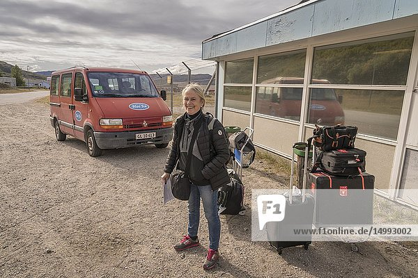 Female tourist with her luggage at the airport  Narsarsuaq  South Greenland.