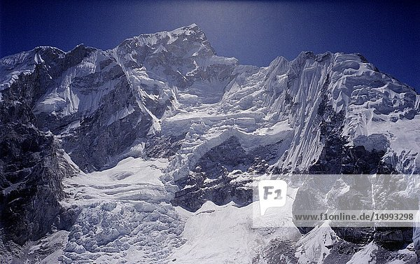 NEPAL Mount Nuptse -- Dec 2005 -- Landscape showing the glacier on the western slope of Mount Nuptse ( 7879 metre summit - and part of the Everest Massif ) in the Khumbu Himalaya ( Everest region ) of Nepal -- Picture by Jonathan Mitchell/Atlas Photo Archive.