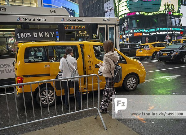 Tourists enter a taxi in Times Square in New York on /Sunday  December 2  2018.