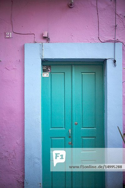 A door paint in blue in a pink wall in Guanajuato  Mexico.