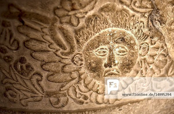 A sun carved on a stone decorates a church in Oaxaca  Mexico.