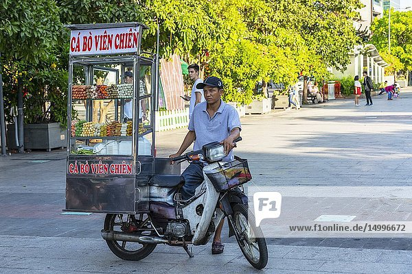 Mobile food vending on the back of a motorcycle  Ho Chi Minh City  Vietnam  Asia.