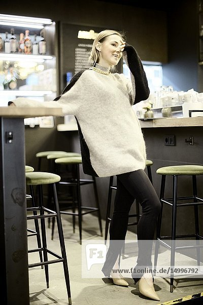 Fashionable blogger woman at bar  in Munich  Germany.