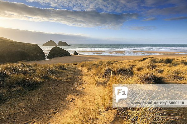 The beach and Carter Rocks at Holywell Bay on the North Coast of Cornwall  captured from the sand dunes on an evening in late February.