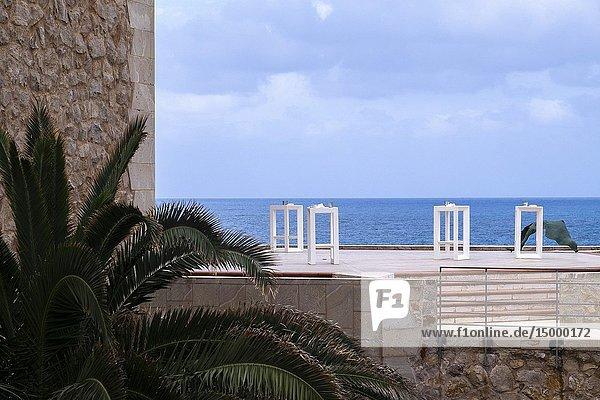 White tables outside the Alfredo Kraus Auditorium  Las Palmas de Gran Canaria.