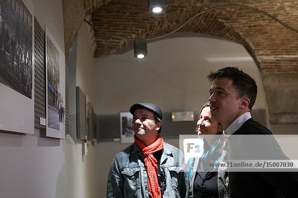 Iñigo Errejon (R) seen attending the explanations of photographer Javier Marquerie (L) about the exhibition. The candidate of 'Mas Madrid' to the Community  Iñigo Errejon  visits the exhibition 'Madrid  how good you are!' from photographer Javier Marquerie.