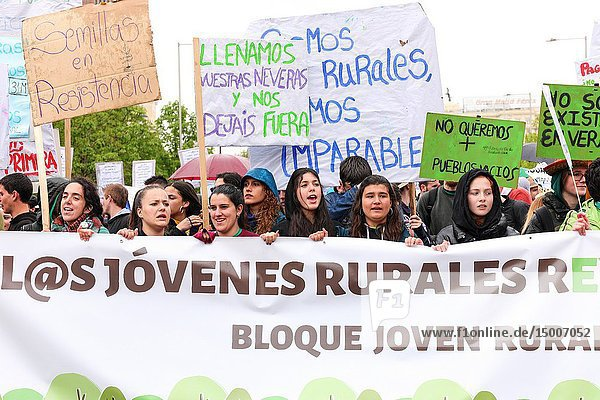 Young participants with a banner claiming that they too in rural areas. 'La Revuelta de la España Vaciada' from the Plaza de Colón in Madrid to Neptuno with a massive participation that makes this march historic  since it is the first time that 90 collectives from 23 provinces come together to stop depopulation