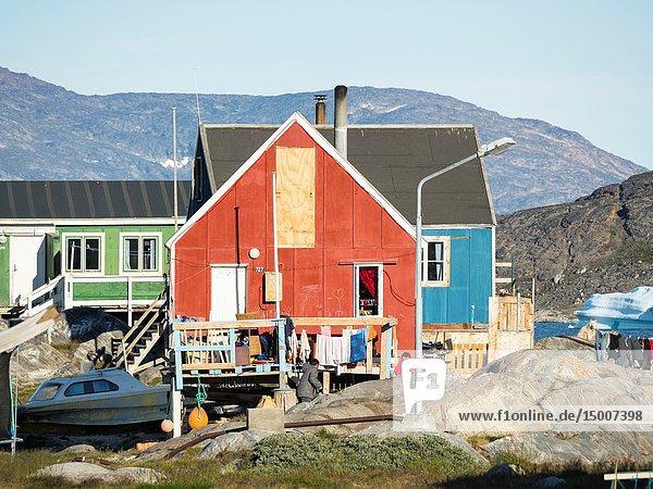 Small fishing village Ikerasak on Ikerask island in the Uummannaq Fjord System. America  North America  Greenland  Uummannaq.