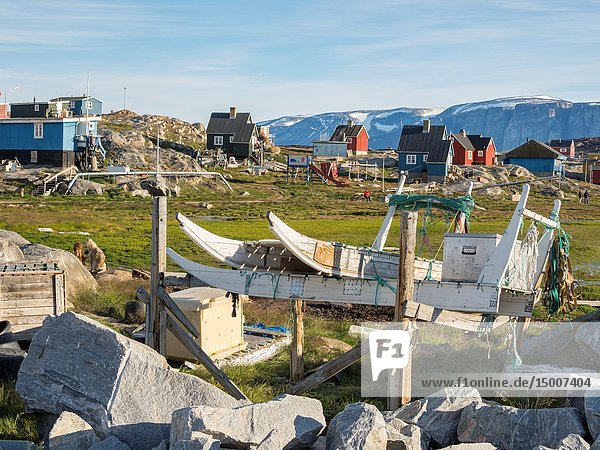 Small fishing village Ikerasak on Ikerask island in the Uummannaq Fjord System. America  North America  Greenland  Uummannaq.