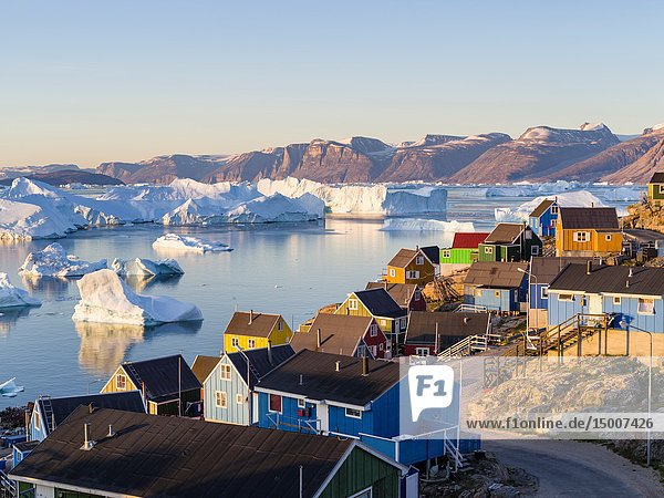 View of fjord full of icebergs towards Nuussuaq (Nugssuaq) peninsula during midnight sun. The town Uummannaq in the north of West Greenland,  located on an island in the Uummannaq Fjord System. America,  North America,  Greenland.