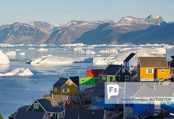 The town Uummannaq in the north of West Greenland  located on an island in the Uummannaq Fjord System  in background the Nuussuaq (Nugssuaq) Peninsula. America  North America  Greenland.