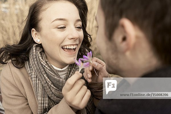 Young teenage couple with purple flowers of spring outdoors in nature  in Cottbus  Brandenburg  Germany