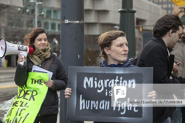 Detroit  Michigan USA - 14 March 2019 - Protesters picketed outside as immigration hard liners held a public meeting to promote construction of a wall along the Mexican border. The 'We Build the Wall' event promoted an organization of the same name that is trying to raise individual contributions to fund wall construction.