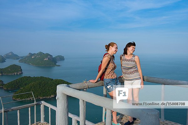 Two female tourists on top of the Ko Wua Ta Lap island in Ang Thong national marine park.