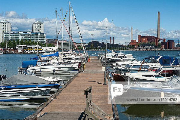 Helsinki  Finland  Europe - Boats at a jetty in the Finnish capital with apartment buildings in the backdrop.