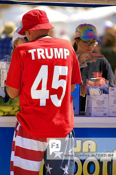 Man dressed from head to toe showing his support for President Trump buys a smoothie at the Tucson Airshow AZ.