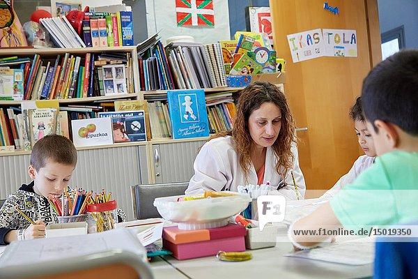 Teacher with children in a classroom of studies and games  Plant for hospitalization of children  Pediatrics  Medical care  Hospital Donostia  San Sebastian  Gipuzkoa  Basque Country  Spain.