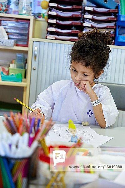 Girl in the classroom of studies and games  Plant for hospitalization of children  Pediatrics  Medical care  Hospital Donostia  San Sebastian  Gipuzkoa  Basque Country  Spain.