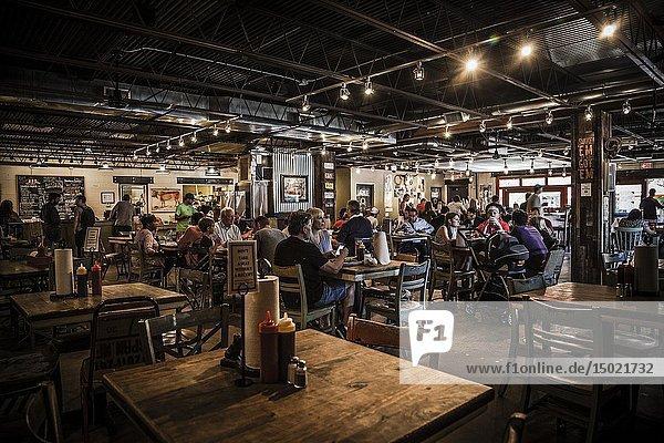 People having bbq lunch at Pecan Lodge  Deep Ellum  Dallas  Texas.