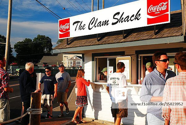Vacationer line up at a clam shack on the river in Kennebunkport  Maine.