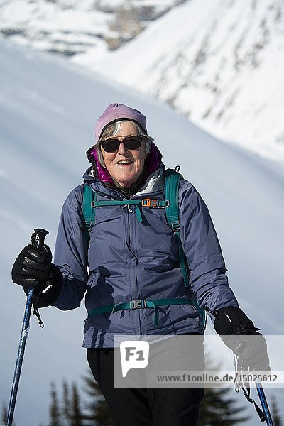 Portrait of a woman snowshoer  72  smiling on Parker Ridge  Banff National Park  Alberta  Canada