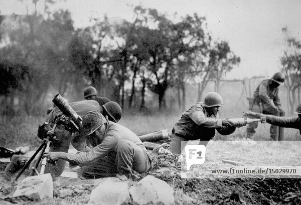 ITALY Massa-- Nov 1944 -- Members of a US Army mortar company of the 92nd Division pass the ammunition and heave it over at the Germans in an almost endless stream near Massa  Italy. This company is credited with liquidating several machine gun nests -- Picture by Bull / Lightroom Photos / US Army *Best quality available. NB Not retouched for dust & scratches.