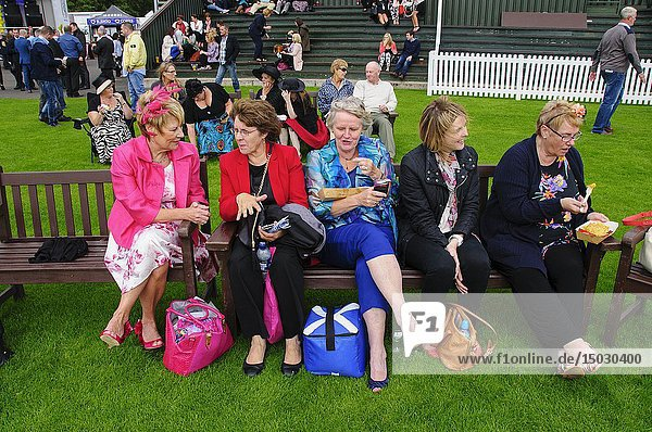 UK SCOTLAND Perth -- 16 Aug 2014 -- Ladies chat at Perth Races in Scotland UK -- Picture by Jonathan Mitchell/Atlas Photo Archive.