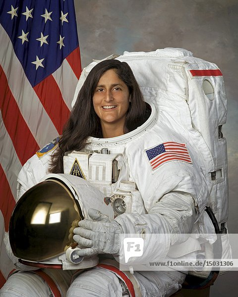 USA -- 22 Sep 2004 -- US NASA astronaut Sunita L Williams in a formal studio portrait sitting in spacesuit -- Picture by Lightroom Photos/NASA.