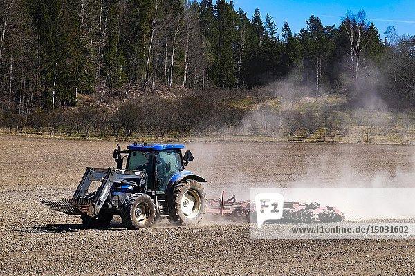 Tractor on field in Sweden.