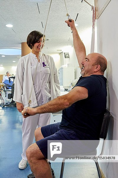 Physiotherapist with patient in rehabilitation machine  gym  Rehabilitation  Amara Berri Health Center building  Donostia  San Sebastian  Gipuzkoa  Basque Country  Spain