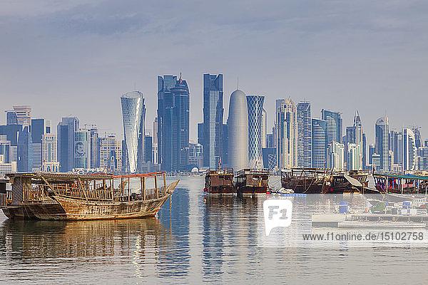 Boats by skyscraper skyline in Doha  Qatar