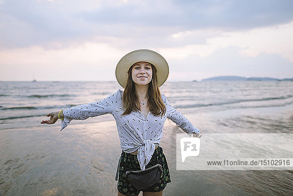 Young woman in sun hat on beach in Krabi  Thailand