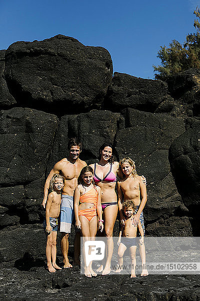 Family portrait on rocks at beach