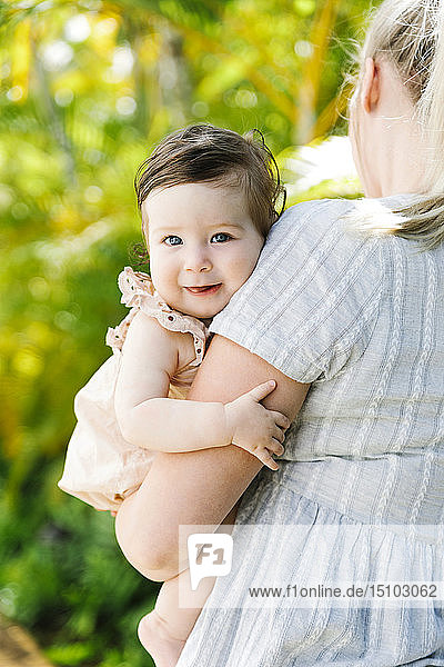 Baby girl being held by her mother