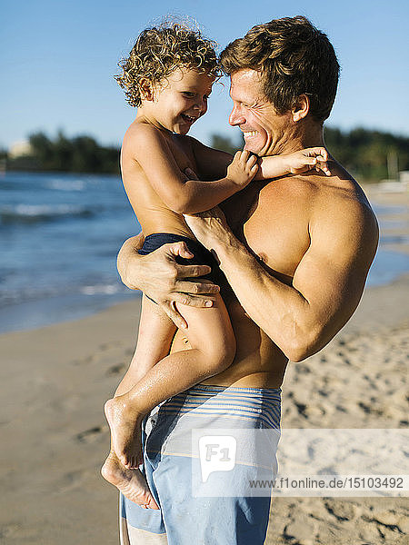 Man playing with his son on beach