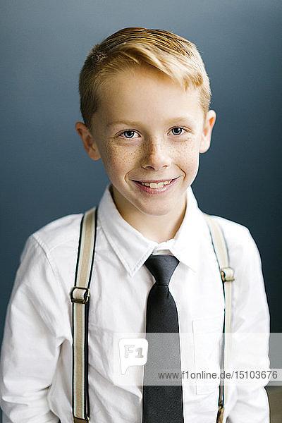 Portrait of smiling boy wearing tie